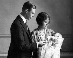 1926, The Duke and Duchess of York (later King George VI and Queen Elizabeth, the Queen Mother) pictured with their daughter (later, Queen Elizabeth II) as she sleeps in a precious christening robe, which has been used in the Royal Family for generations  (Photo by Popperfoto/Getty Images)
