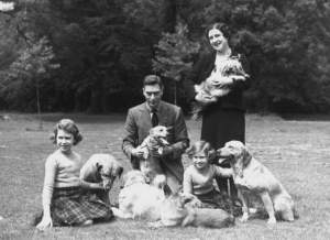 June 1936:  King George VI (1895 - 1952) and Queen Elizabeth with Princesses Margaret Rose (1930 - 2002) and Elizabeth (left) in the grounds of Windsor Castle, Berkshire.  (Photo by Lisa Sheridan/Studio Lisa/Getty Images)