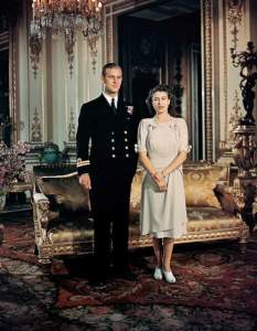 19 Aug 1947, London, England, UK --- Princess Elizabeth stands with fiancee Lieutenant Philip Mountbatten, Prince of Greece and Denmark. --- Image by © Bettmann/CORBIS