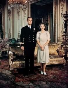 19 Aug 1947, London, England, UK --- Princess Elizabeth stands with fiancee Lieutenant Philip Mountbatten, Prince of Greece and Denmark. --- Image by © Bettmann/CORBIS