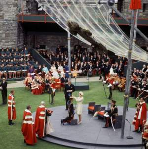 Mandatory Credit: Photo by Reginald Davis / Rex USA (504191eh) The Investiture of Prince Charles as Prince of Wales and Earl of Chester at Caernarvon Castle. He kneels before Queen Elizabeth II and she crowns him the 21st Prince of Wales with a jewelled encrusted coronet. Queen Elizabeth II retrospective