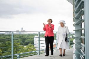 BERLIN, GERMANY - JUNE 24:  In this photo provided by the German Government Press Office (BPA), Angela Merkel welcomes Queen Elizabeth II upon her arrival at the Federal Chancellery on the second of the royal couple's four-day visit to Germany on June 24, 2015 in Berlin, Germany. The Queen and Prince Philip are scheduled to visit Berlin, Frankfurt and the concentration camp memorial at Bergen-Belsen during their trip, which is their first to Germany since 2004.  (Photo by Bergmann/Bundesregierung via Getty Images)
